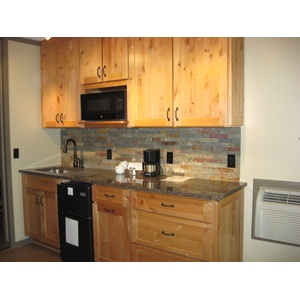 Kitchen cabinets in Knotty Alder wood with Natural finish