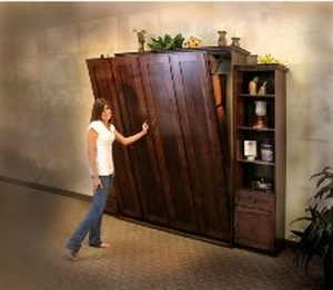 Girl opening Murphy Bed