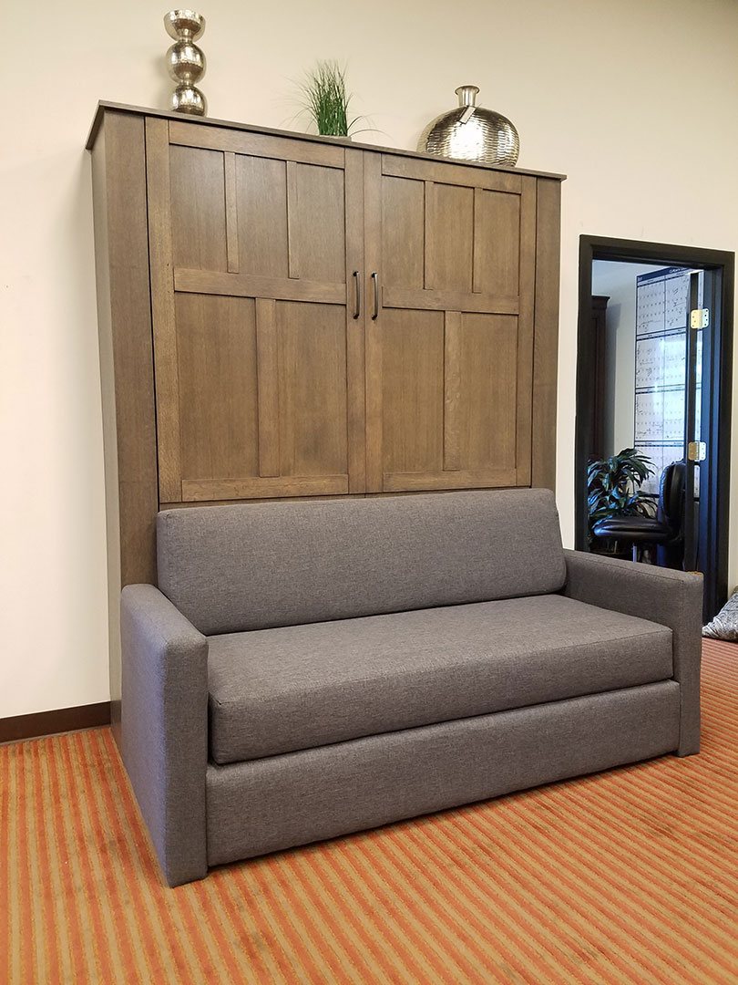 Murphy bed with gray sofa