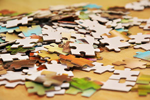 People putting puzzle together, close-up